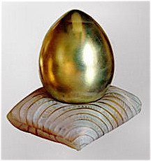 Gold egg on pillow Year 2002